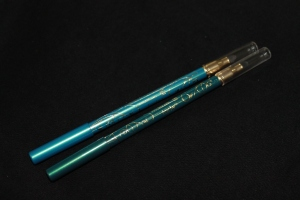 The two eyeliners, Amazonite Blue on the left and Emerald on the right.